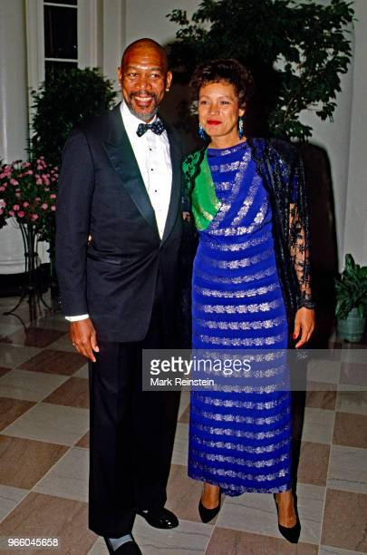 Actor Morgan Freeman and his wife Myrna Colley-Lee arrive at the White House to attend a state dinner Washington DC, 1990.