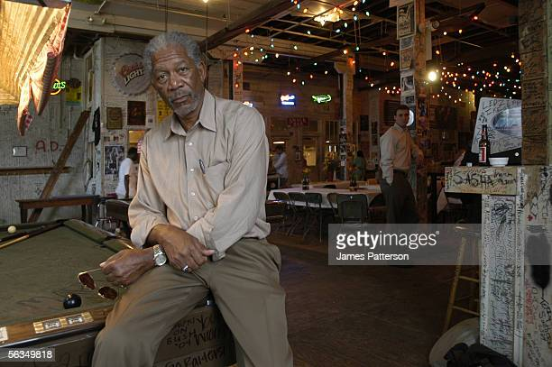 Actor Morgan Freeman poses on the pool table at Ground Zero blues club on September 23 2005 in Clarksdale Mississippi