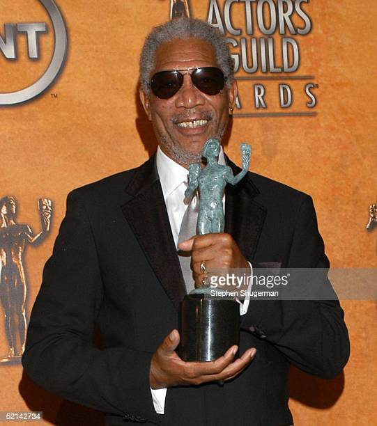 Actor Morgan Freeman poses with his award for Outstanding Performance by a Male Actor in a Supporting Role in the press room at the 11th Annual...