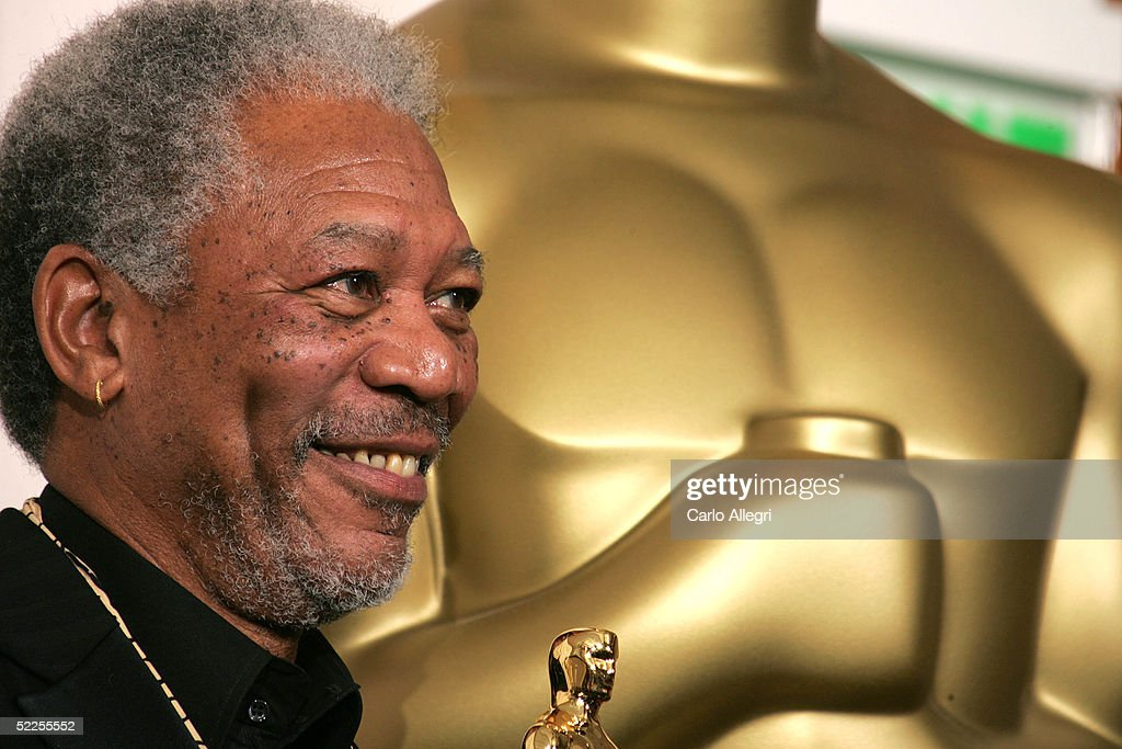 Actor Morgan Freeman poses with his 'Best Actor in a Supporting Role' award for his performance in 'Million Dollar Baby' backstage during the 77th Annual Academy Awards on February 27, 2005 at the Kodak Theater in Hollywood, California.