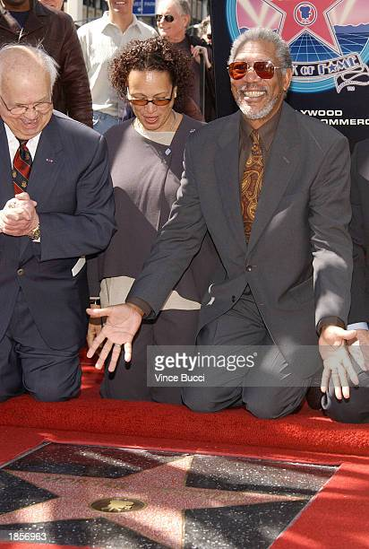 Actor Morgan Freeman poses with his wife Myrna Colley and honorary mayor of Hollywood Johnny Grant at a ceremony honoring Freeman with a star on the...