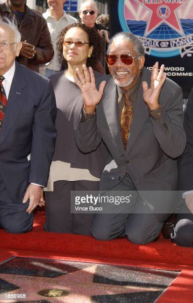Actor Morgan Freeman poses with his wife Myrna Colley at a ceremony honoring him with a star on the Hollywood Walk of Fame on March 18 2003 in...