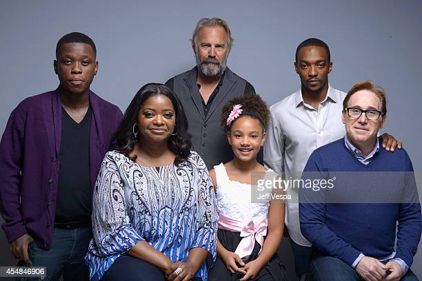 Actor Mpho Koaho actress Octavia Spencer actor Kevin Costner Jillian Estell actor Anthony Mackie and director Mike Binder of Black and White pose for...