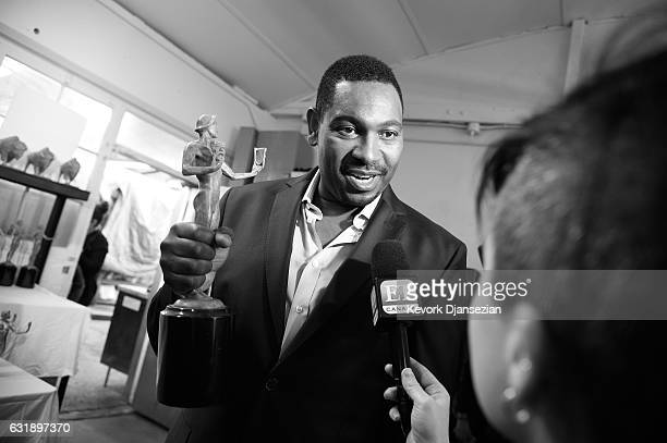 Actor Mykelti Williamson poses at the pouring of the actor statuette for the 23rd Annual Screen Actors Guild Awards at American Fine Arts Foundry on...