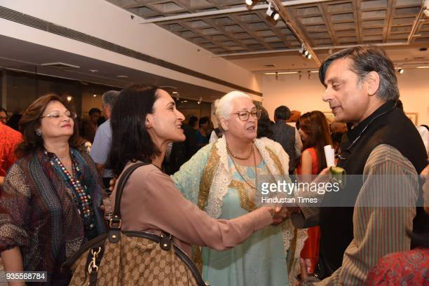 Actor Nafisa Ali and Congress leader Shashi Tharoor during an art exhibition of paintings drawings mixed media works on paper canvas and wood by...