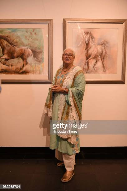 Actor Nafisa Ali during an art exhibition of paintings drawings mixed media works on paper canvas and wood by artists Sujata Dere and Pritam Mehta at...