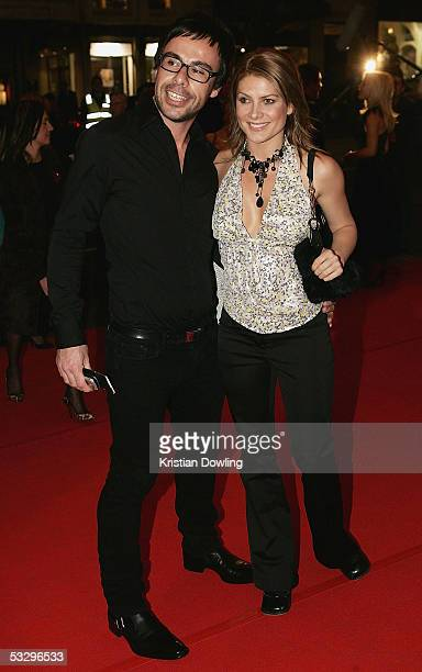 Actor Natalie Bassingthwaighte and Brad Mullins walk the red carpet at the Melbourne Premiere of The Lion King at the Regent Theatre on July 28 2005...