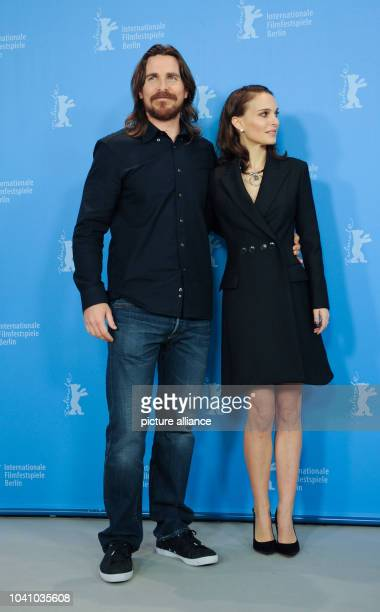 US actor Natalie Portman and British actor Christian Bale pose at a photo shoot for 'Knight of Cups' at the 65th International FilmFestival in...