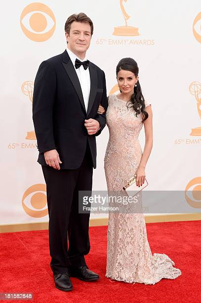 Actor Nathan Fillion and actress Mikaela Hoover arrive at the 65th Annual Primetime Emmy Awards held at Nokia Theatre L.A. Live on September 22, 2013...