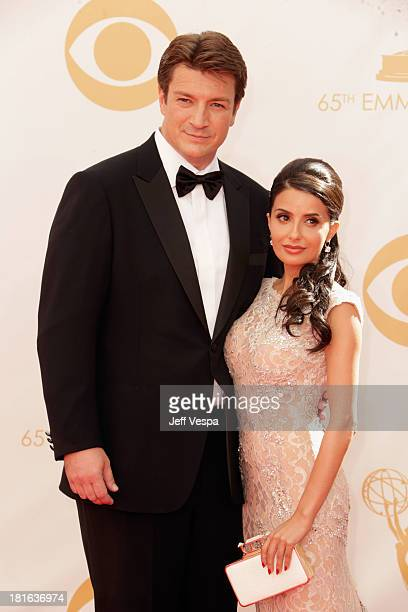 Actor Nathan Fillion and actress Mikaela Hoover arrive at the 65th Annual Primetime Emmy Awards held at Nokia Theatre LA Live on September 22 2013 in...