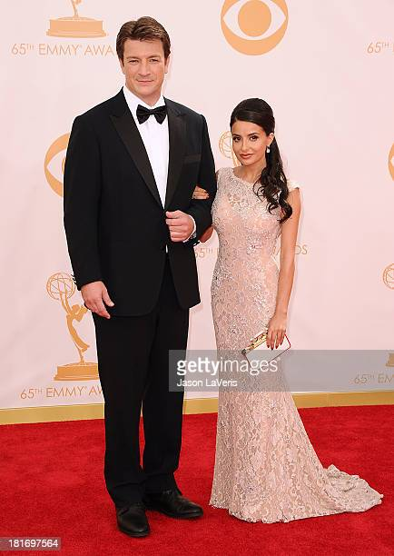 Actor Nathan Fillion and actress Mikaela Hoover attend the 65th annual Primetime Emmy Awards at Nokia Theatre L.A. Live on September 22, 2013 in Los...