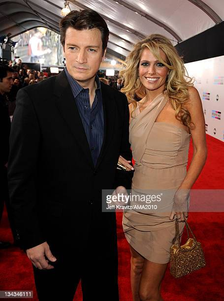 Actor Nathan Fillion and guest arrive at the 2010 American Music Awards at Nokia Theatre LA Live on November 21 2010 in Los Angeles California