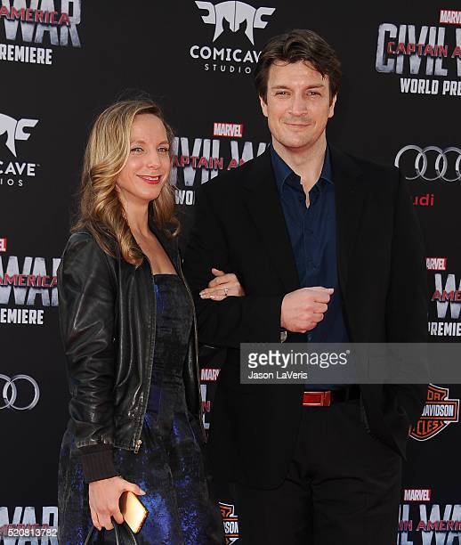 Actor Nathan Fillion and guest attend the premiere of 'Captain America Civil War' at Dolby Theatre on April 12 2016 in Hollywood California