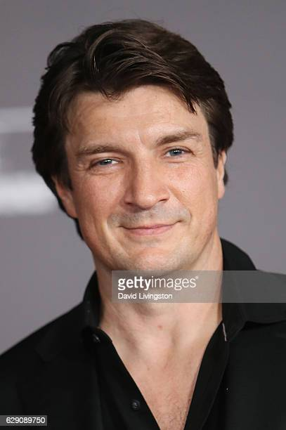 Actor Nathan Fillion arrives at the premiere of Walt Disney Pictures and Lucasfilm's Rogue One A Star Wars Story at the Pantages Theatre on December...