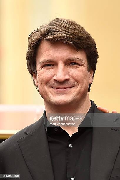 Actor Nathan Fillion attends a ceremony honoring Ryan Reynolds with a star on the Hollywood Walk of Fames on December 15 2016 in Hollywood California