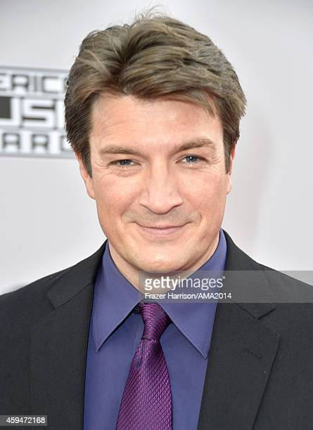 Actor Nathan Fillion attends the 2014 American Music Awards at Nokia Theatre LA Live on November 23 2014 in Los Angeles California