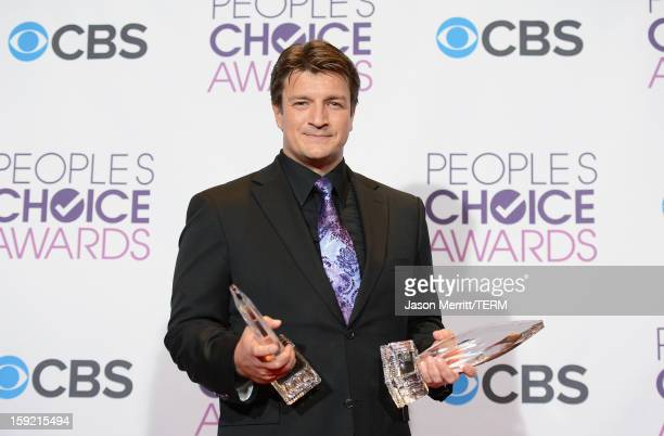 Actor Nathan Fillion winner of Favorite TV Drama Actor and Favorite TV Crime Drama for 'Castle' poses in the press room at the 39th Annual People's...