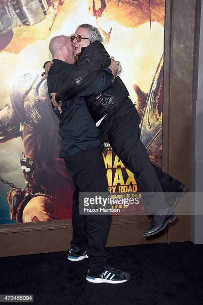 "Actor Nathan Jones picks up writer/director/producer George Miller during the premiere of Warner Bros. Pictures' ""Mad Max: Fury Road"" at TCL Chinese..."