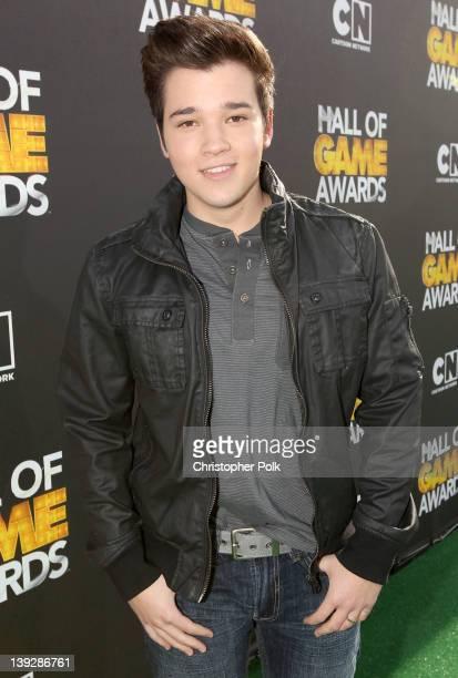 Actor Nathan Kress arrives at the 2012 Cartoon Network Hall of Game Awards at Barker Hangar on February 18 2012 in Santa Monica California...