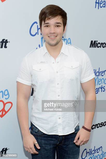 Actor Nathan Kress performs onstage at the Children Mending Hearts 4th Annual Spring Benefit on April 22 2012 in Pacific Palisades California