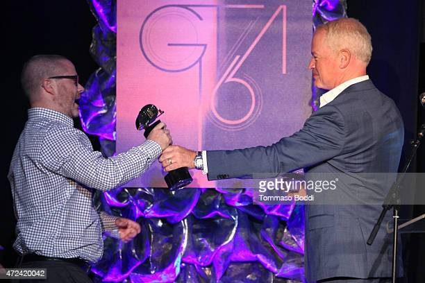 Actor Neal McDonough honors the winners of Best Comedy Trailer producer Adam Mays and editor Brandon Selter on stage during the 16th annual Golden...
