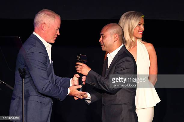 Actor Neal McDonough honors Winner of the Golden Trailer Award for Best Documentary Trailer creative director Scott Mitsui on stage during the 16th...