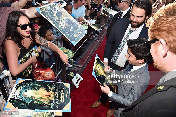 Actor Neel Sethi signs autographs for fans at The World Premiere of Disney's 'THE JUNGLE BOOK' at the El Capitan Theatre on April 4 2016 in Hollywood...