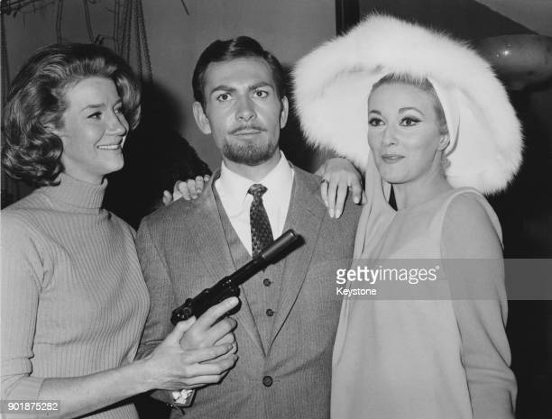 Actor Neil Connery the brother of James Bond star Sean Connery poses with actresses Lois Maxwell and Daniela Bianchi at a press conference for the...