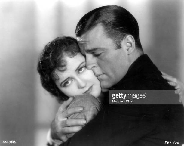Actor Neil Hamilton and actress Doris Hill in a passionate embrace in the film 'The Studio Murder Mystery' directed by Frank Tuttle for Paramount