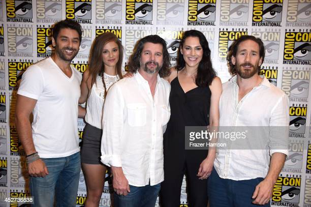 """Actor Neil Napier, actress Jordan Hayes, writer/producer Ronald D. Moore, actress Kyra Zagorsky, and actor Mark Ghanime attend the """"Helix"""" press line..."""