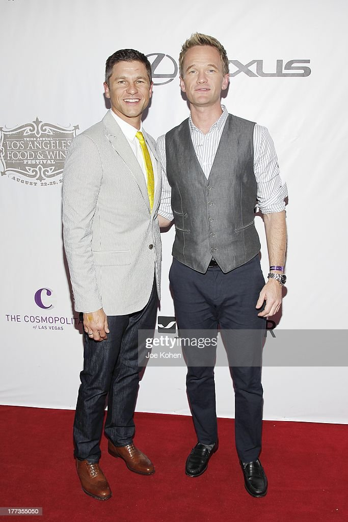 Actor Neil Patrick Harris (R) and David Burtka attends the 2013 Los Angeles Food & Wine Festival 'Festa Italiana With Giada De Laurentiis' Opening Night Gala on August 22, 2013 in Los Angeles, California.