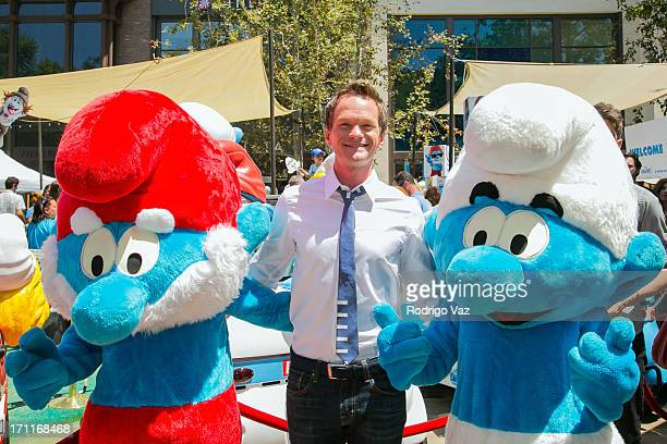 Actor Neil Patrick Harris Papa Smurf and Clumsy Smurf attend Global Smurfs Day Celebration at The Grove on June 22 2013 in Los Angeles California