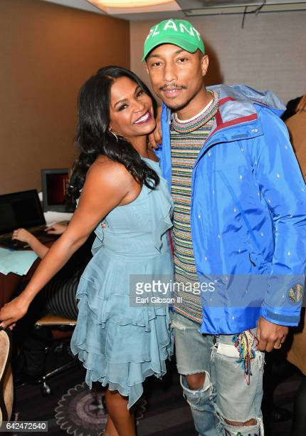 Actor Nia Long and singersongwriter Pharrell Williams attend BET Presents the American Black Film Festival Honors on February 17 2017 in Beverly...