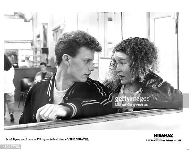 Actor Niall Byrne and actress Lorraine Pilkington in a scene from the movie The Miracle circa 1991