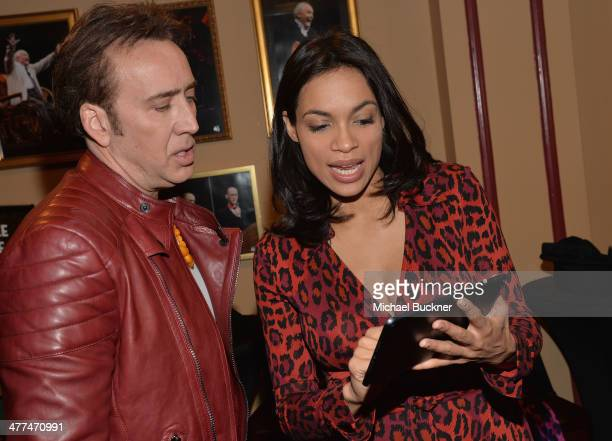 Actor Nicholas Cage and actress Rosario Dawson pose for photos in the green room for the premiere of 'Joe' during the 2014 SXSW Music Film...
