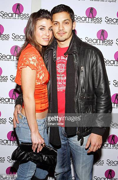 Actor Nicholas Gonzalez and girlfriend Monica Allgeier arrive at the grand opening of the Seamless Adult Ultra Lounge early December 18 2005 in Las...