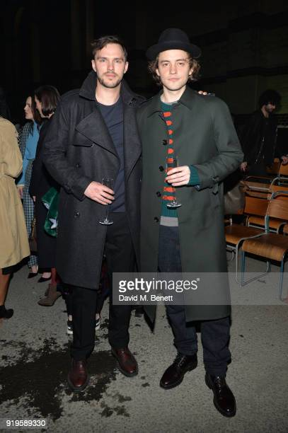 Actor Nicholas Hoult and Josh Whitehouse wearing Burberry at the Burberry February 2018 show during London Fashion Week at Dimco Buildings on...