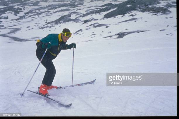 Actor Nicholas Lyndhurst skiing in character as Ashley Phillips in sitcom The Two Of Us, circa 1989.