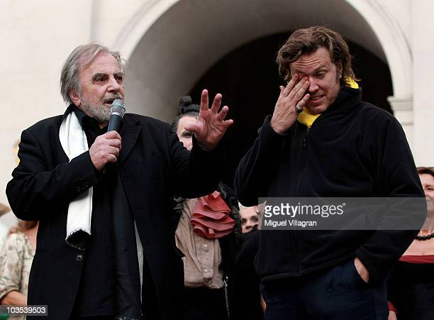 Actor Nicholas Ofczarek reacts as actor Maximillian Schell addresses the audience during the celebration of the 90th jubilee of the Jedermann play on...