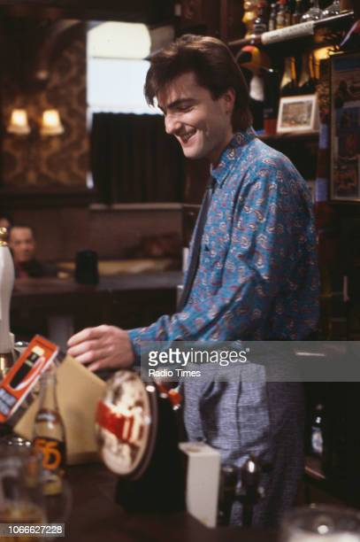 Actor Nick Berry behind the bar of the Queen Victoria pub in a scene from the BBC soap opera 'EastEnders' January 9th 1985