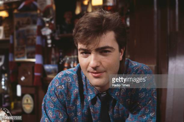 Actor Nick Berry pictured behind the bar of the Queen Victoria pub on the set of the BBC soap opera 'EastEnders' January 9th 1985