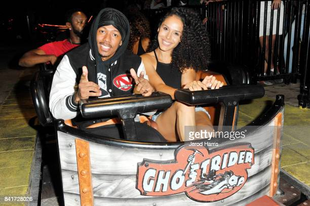 Actor Nick Cannon and Brittany Bell ride the 'Ghostrider' Roller Coaster at Knott's Berry Farm on September 1 2017 in Buena Park California