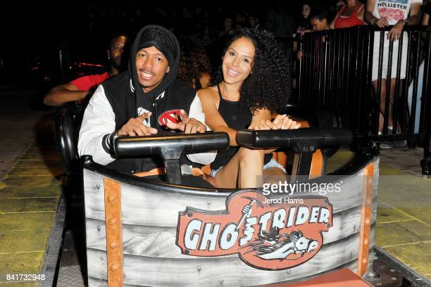 Actor Nick Cannon and Brittany Bell ride the 'Ghostrider' Roller Coaster at Knott's Berry Farm on September 1, 2017 in Buena Park, California.