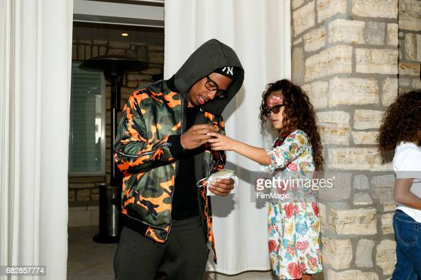 Actor Nick Cannon and Monroe Cannon attend the Moroccan Scott Cannon and Monroe Cannon Party on Mary 13 in Los Angeles California