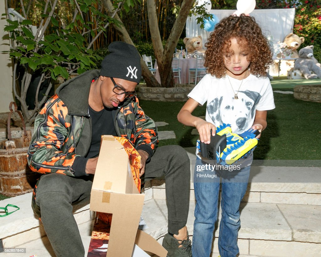 Actor Nick Cannon (L) and Moroccan Scott Cannon attend the Moroccan Scott Cannon and Monroe Cannon Party on Mary 13 in Los Angeles, California.
