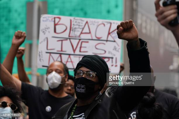 US actor Nick Cannon holds up a fist along with Black Lives Matter protesters demonstrate in Times Square over the death of George Floyd by a...