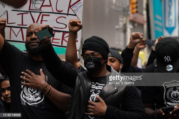US actor Nick Cannon holds up a fist along with Black Lives Matter protesters demonstrating in Times Square over the death of George Floyd by a...