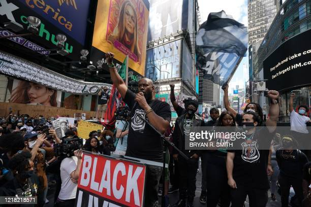 US actor Nick Cannon listen to a man speak as Black Lives Matter New York protesters demonstrate in Times Square over the death of George Floyd by a...