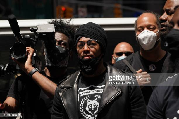 US actor Nick Cannon looks on as he joins a Black Lives Matter protest in Times Square over the death of George Floyd by a Minneapolis police officer...