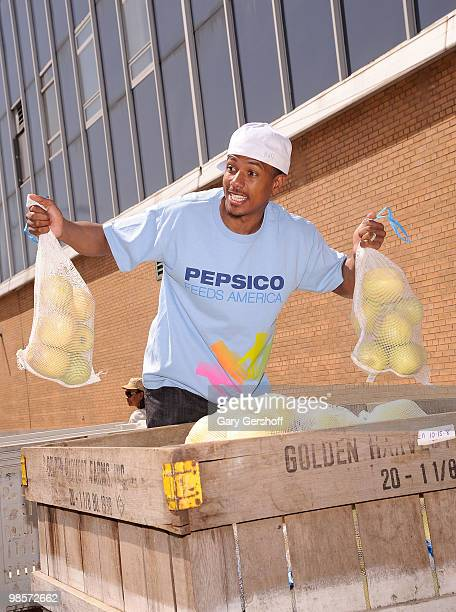 Actor Nick Cannon , Pepsi Co. Employees and Feeding America help feed 2 million people during a national day of service at City Harvest on April 20,...